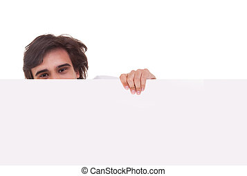 Young man holding a white board, looking to camera, isolated on a white background