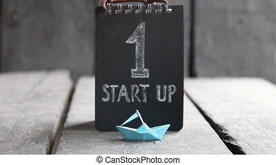 start-up - New Business concept, text and paper boat -...