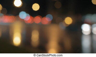 Defocus of car traffic at night - Defocused shot of...