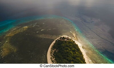 Aerial view beautiful beach on tropical island. Mantigue island Philippines.