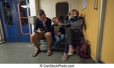 Timelapse of family with child in subway train
