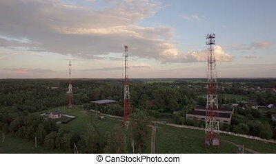 View of forest, country houses and base stations against...