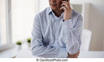 businessman calling on smartphone at office - business,...