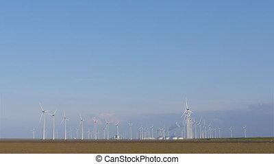 Windmill turbine park near heavy industry - Windmill...