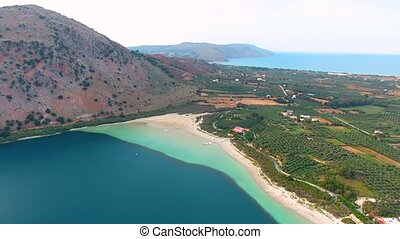 flying above beautiful Lake Kournas at Crete - Aerial view...
