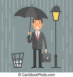 Businessman standing with umbrella in rain