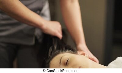 woman having head massage at spa - people, beauty, lifestyle...