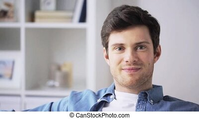 happy smiling young man at home - people, emotion,...