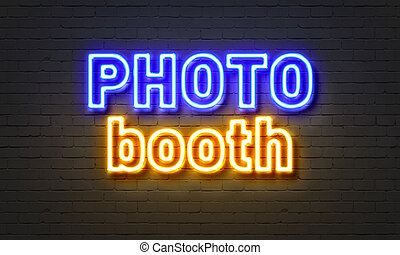 Photo booth neon sign on brick wall background. - Photo...