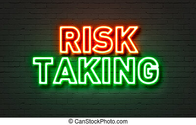 Risk taking neon sign on brick wall background. - Risk...