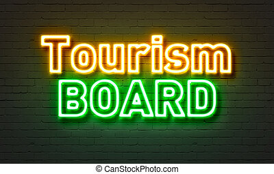 Tourism board neon sign on brick wall background. - Tourism...