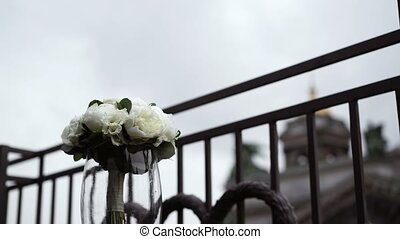 Bouquet on balcony at cloudy day