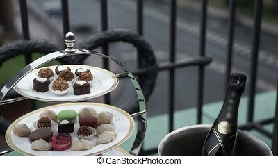 Sweets and champagne on balcony
