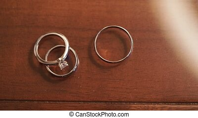 Three wedding rings on table