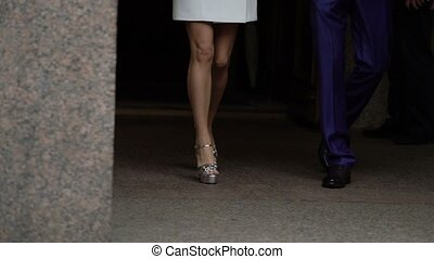 Young couple walking legs shot