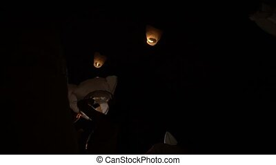 Sky lanterns at night