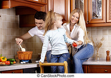 Family idyll - The family on kitchen makes a dinner