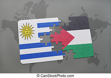 puzzle with the national flag of uruguay and palestine on a...