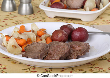 Sliced Pot Roast - Sliced pot roast with carrots, onions,...