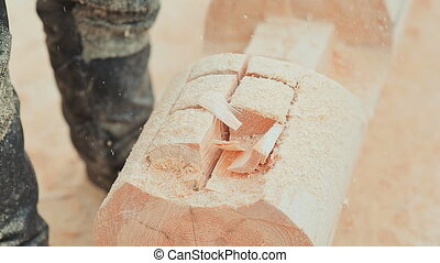Carpenter carve a semicircle in the log. Canadian angle...