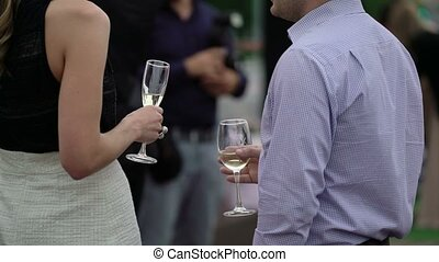 Woman and man with glasses of champagne