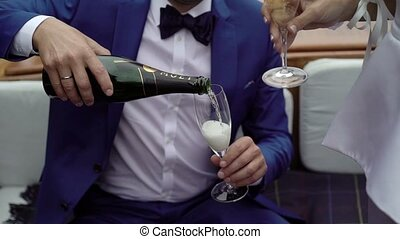Man pours champagne in glass