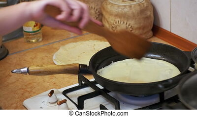 Cooking of the Dough Pancakes, Flat Cakes on the Hot Frying...
