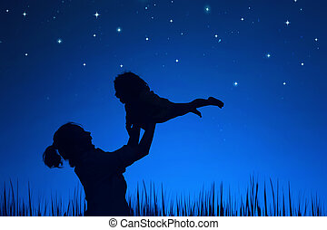 Mother Day Concept - Silhouette of attractive mother playing...
