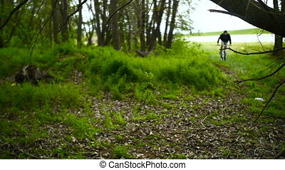 Mountain Biker Ride on Cross-Country - Mountain Biker Making...