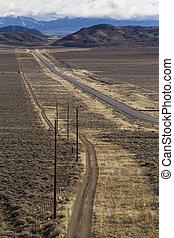 Highway 50 in the Nevada desert. The loneliest road in...
