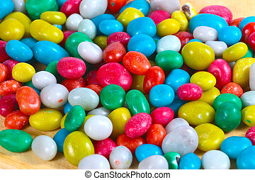 colorful sugar dragees - Sweet colorful sugar dragees on a...