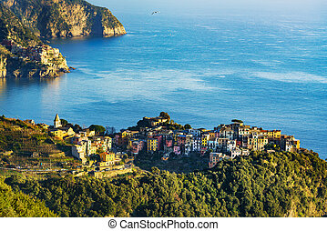 Corniglia village and Manarola in background at sunset. Cinque Terre, Ligury, Italy