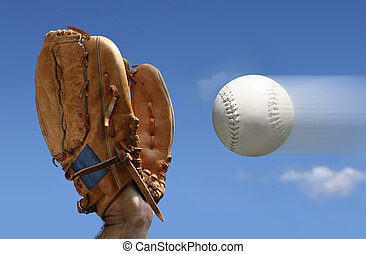 baseball catch - Close-up of a man wearing a baseball glove...