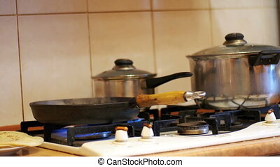 Process Meal Preparation in a Pan on the Stove in a Home...