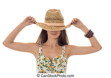 the girl wore a big hat and keeps her hands close-up...