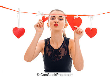 cute young girl sends kiss and keeps the Ribbon with hearts...