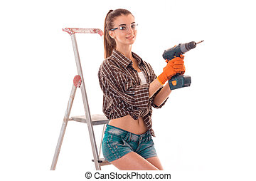 a young girl in a Plaid Shirt and glasses holding a drill...