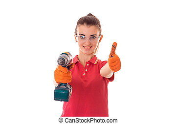 smiling young girl is stretched out in a hand drill and...