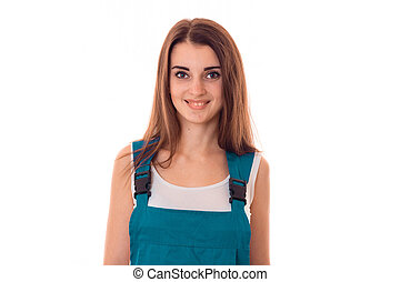 Portrait of a young smiling girl in overalls close-up...
