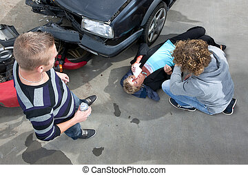 Car crash - Bystanders providing first aid to an injured...