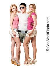 Young man and two beautiful girls. Isolated