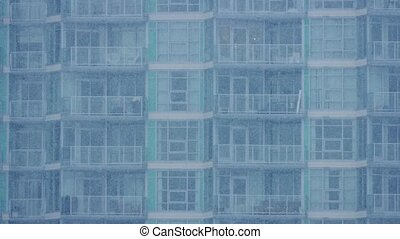 Apartment Building In Heavy Snowfall - City apartments in...