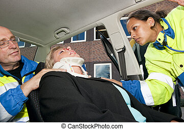 Neck brace - Paramedics placing a neck brace on an injured...