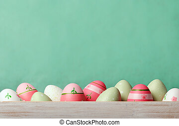 Easter background - Easter eggs on green background