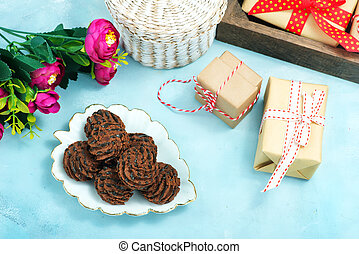 chocolate candy on plate and on a table