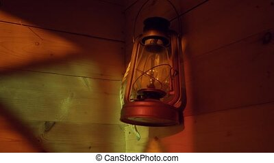 Ancient lamp on a wooden wall. Reflection of stained-glass...