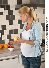 Healthy eating - Attractive blond woman eating healthy food...