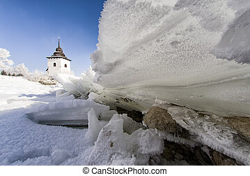 Frozen lake. Ice floe. Church - Ice floe on frozen lake...