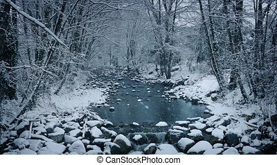 River In Snowy Woodland - Pretty winter scene of...
