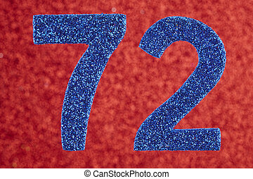 Number seventy-two blue color over a red background....